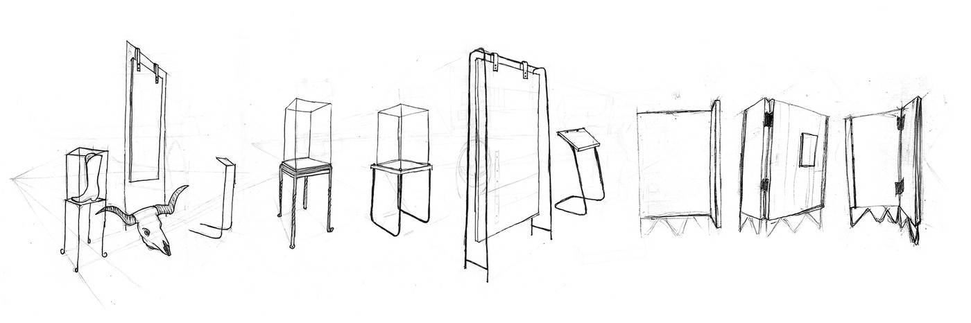sketches of large vertical panels and vitrine cases supported by thick wire frames with a cowboy boot and steer skull thrown in for good measure