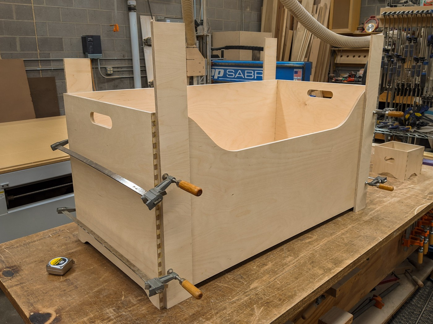 A plywood box clamped for gluing