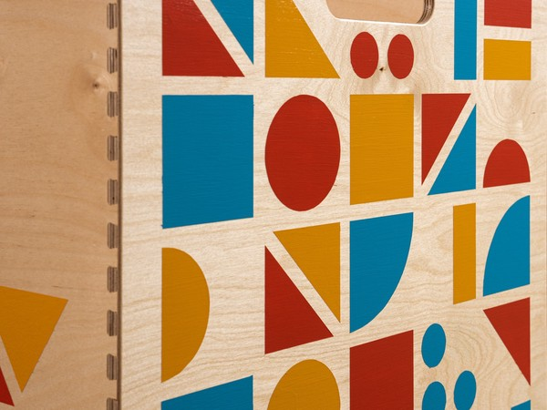 close up of a wooden surface covered in colorful geometric shapes